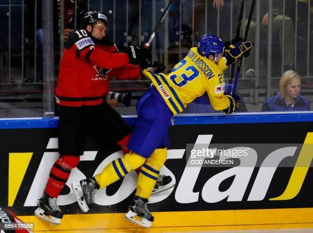 Canada's Brayden Schenn and Sweden's Oliver EkmanLarsson vie during the IIHF Men's World Championship Ice Hockey final match between Canada and...
