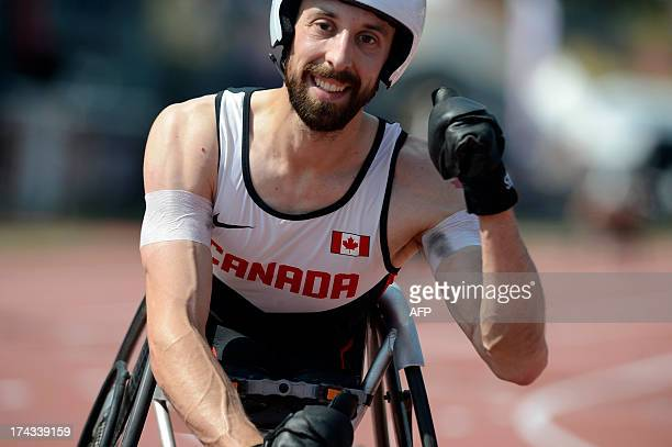 Canada's Brent Lakatos celebrates as he crosses the finish line to win the Men's 200m T53 on July 24 2013 during the IPC Athletics World...