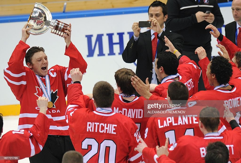 Canada's captain Sam Reinhart (L) and members of the Canadian team celebrate with their trophy after their 3-2 victiory over team USA during the IIHF U18 International Ice Hockey World Championships final game in Sochi on April 28, 2013.