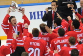 Canada's captain Sam Reinhart and members of the Canadian team celebrate with their trophy after their 32 victiory over team USA during the IIHF U18...