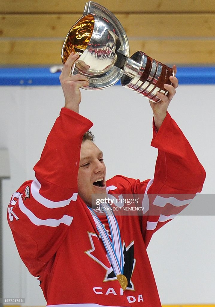 Canada's captain Sam Reinhart holds up the trophy after Canada's 3-2 victiory over team USA during the IIHF U18 International Ice Hockey World Championships final game in Sochi on April 28, 2013.