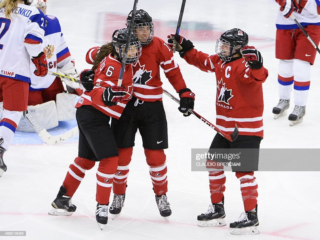 Canada's <a gi-track='captionPersonalityLinkClicked' href=/galleries/search?phrase=Caroline+Ouellette&family=editorial&specificpeople=722185 ng-click='$event.stopPropagation()'>Caroline Ouellette</a>, (C) celebrates with team mates Rebecca Johnston, (L) and <a gi-track='captionPersonalityLinkClicked' href=/galleries/search?phrase=Marie-Philip+Poulin&family=editorial&specificpeople=5805854 ng-click='$event.stopPropagation()'>Marie-Philip Poulin</a> after scoring the opening goal during the 2015 IIHF Ice Hockey Women's World Championship group A match between Canada and Russia at Malmo Isstadion in Malmo, southern Sweden, on March 29, 2015.