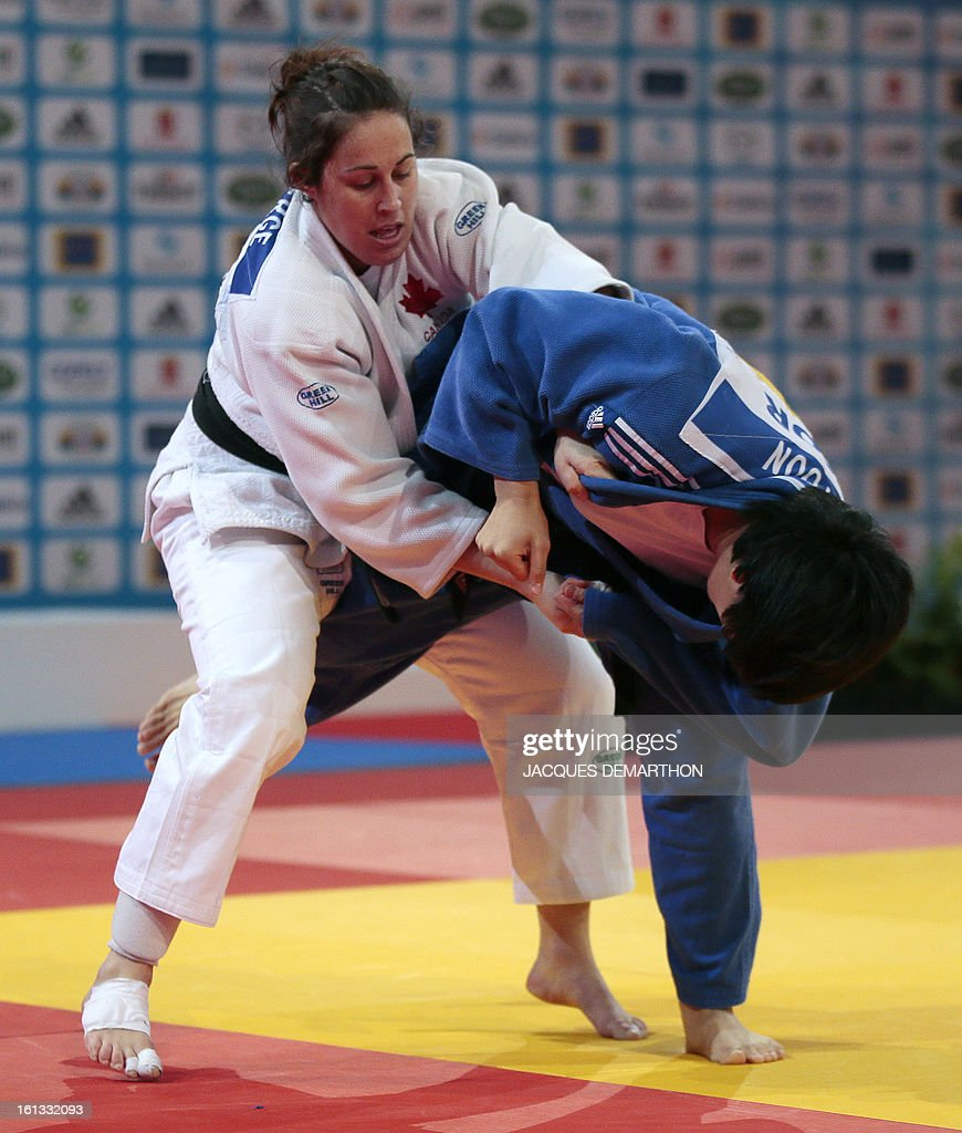 Canada's Catherine Roberge (white) fights against Korea's Yoon Hyunji (blue) on February 10, 2013 in Paris, during the eliminatories of the Women - 78kg of the Paris Judo Grand Slam tournament. AFP PHOTO
