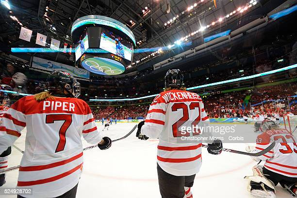 Canada's Cherie Piper Canada's Hayley Wickenheiser Canada's Kim StPierre during Canada vs Finland women's hockey at Canada Hockey Place on day 11 of...
