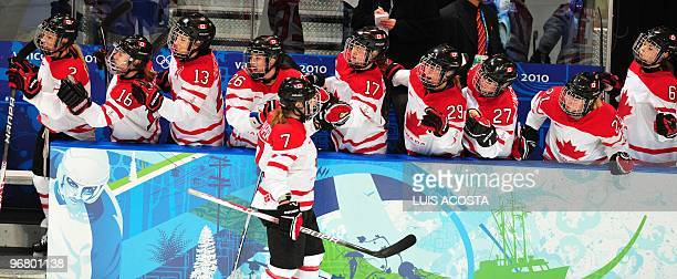 Canada's Cherie Piper celebrates a team goal during the Women's Ice Hockey preliminary game between Canada and Sweden at the UBC Thunderbird Arena...