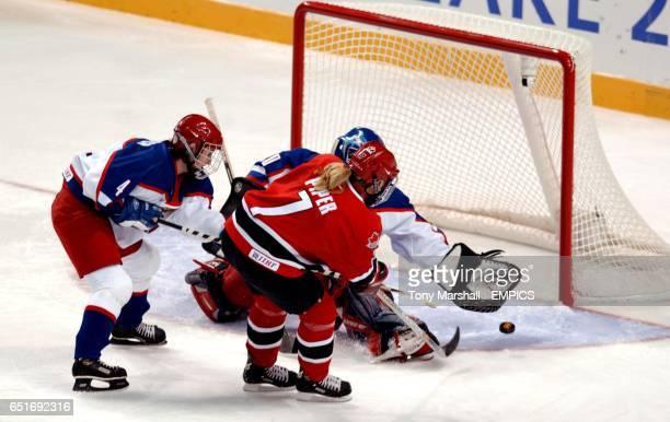 Canada's Cherie Piper shoots toward goal under pressure from Russia's Alena Khomitch and goalkeeper Irina Gashennikova