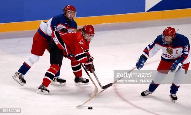 Canada's Cherie Piper tackle's Russia's Zhanna Schelchkova