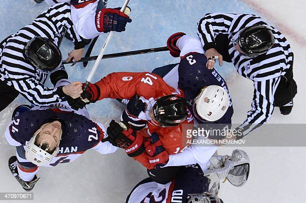 Canada's Chris Kunitz hits US Ryan Callahan during the Men's Ice Hockey Semifinals USA vs Canada at the Bolshoy Ice Dome during the Sochi Winter...