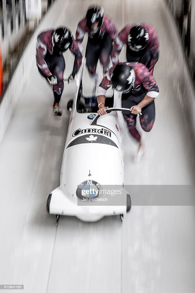 Canada's Chris Spring and his pushers Cameron Stones Derek Plug and Samuel Giguere push their Bob off the start during the first run of the IBSF...
