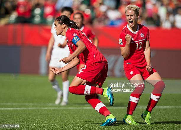 Canada's Christine Sinclair and Sophie Schmidt celebrate Sinclair's goal during injury time in the opening match of the FIFA Women World Cup between...