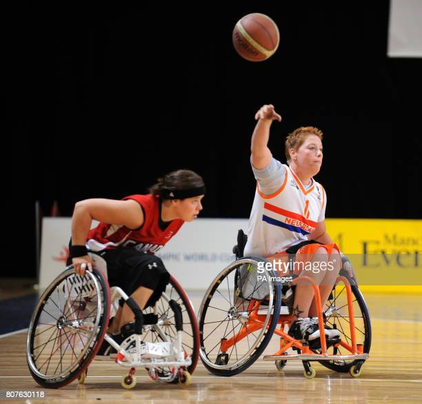 Canada's Cindy Ouellet and Netherland's Cher Korver in the wheelchair basketball during the BT Paralympic World Cup at Sport City Manchester