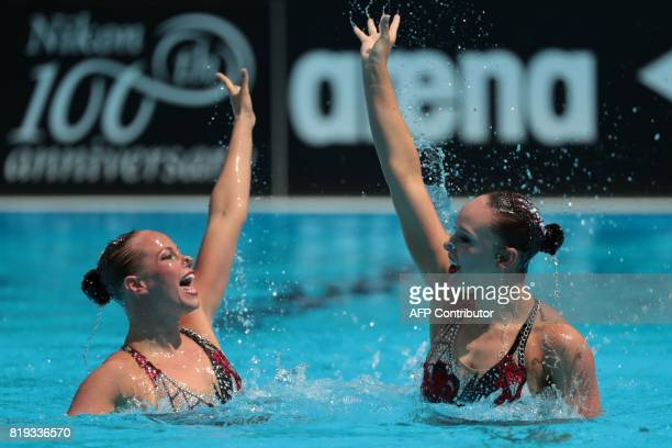 Canada's Claudia Holzner and Canada's Jacqueline Simoneau compete in the Duet Free routine final during the synchronised swimming competition at the...