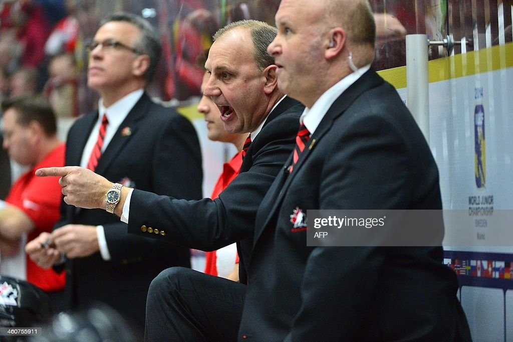 Canada's coach Brent Sutter (C) reacts during the World Junior Hockey Championships bronze medal match between Canada and Russia at Malmo Arena in Malmo, Sweden on January 5, 2014.