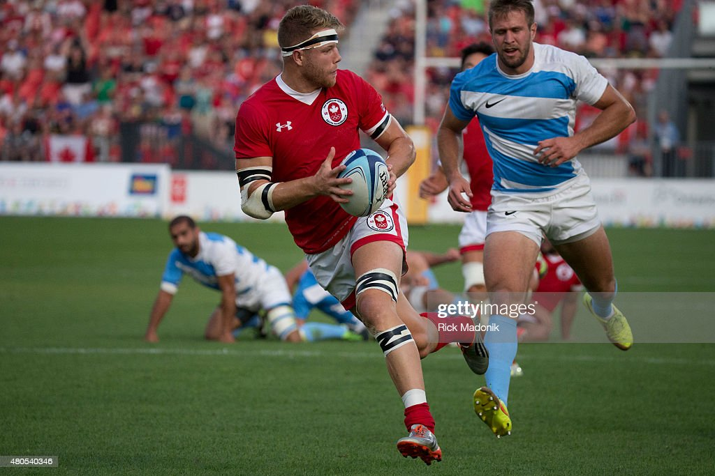 TORONTO, - JULY 12, 2015 - Canada's Conor Trainor breaks free and ends up scoring one of his two try's. Men's Gold medal match between Canada and Argentia of Rugby 7s, at Exhibition Stadium. Toronto 2015 Pan Am coverage. Photographed on JULY 12, 2015. Canada won 22-19.