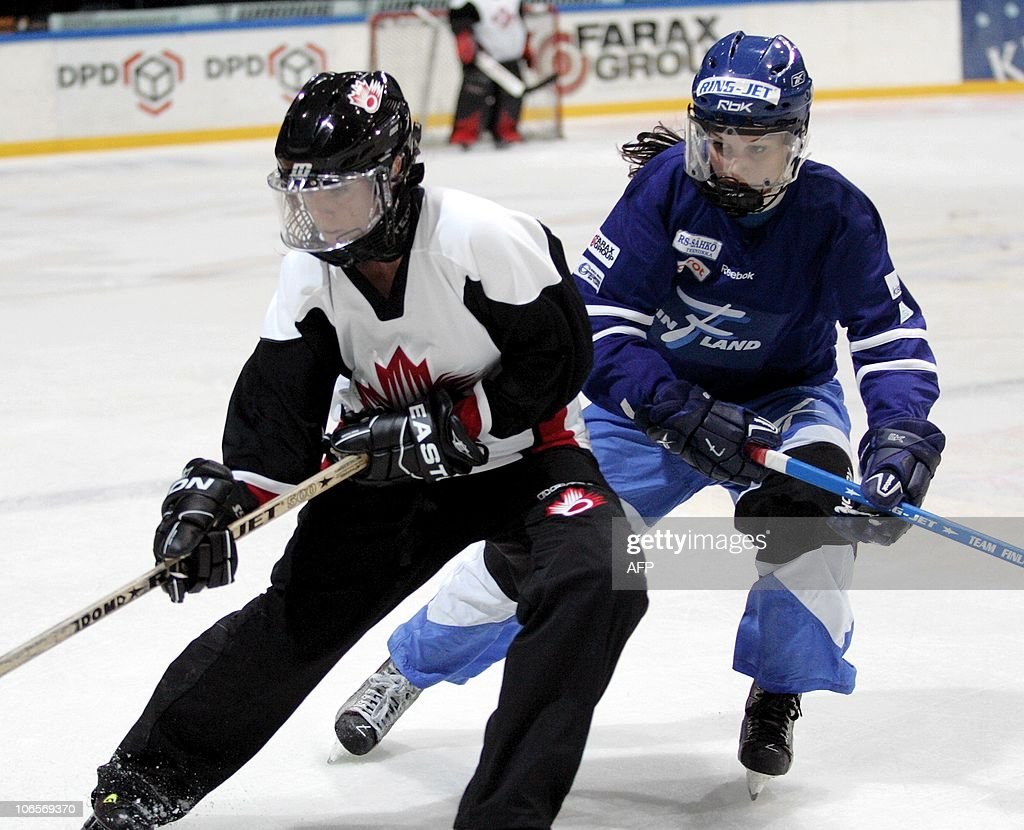 Canada's Dallas Robbins (L) vies with Finland's Susanna Tapani (R) during their World Ringette Championship 2010 second final match in Tampere on November 5, 2010. AFP PHOTO / LEHTIKUVA / Kalle Parkkinen