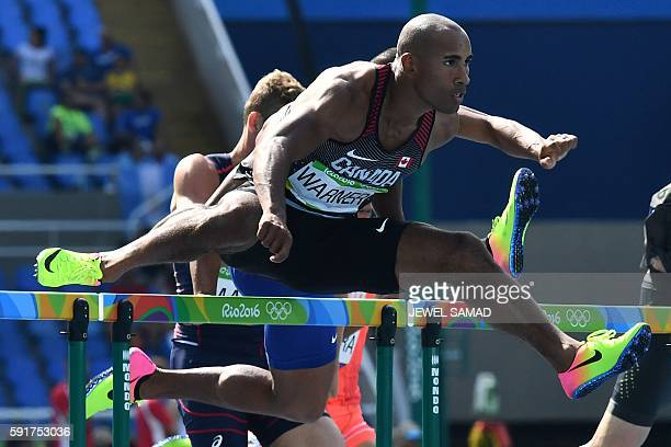 Canada's Damian Warner competes in the Men's Decathlon 110m Hurdles during the athletics event at the Rio 2016 Olympic Games at the Olympic Stadium...