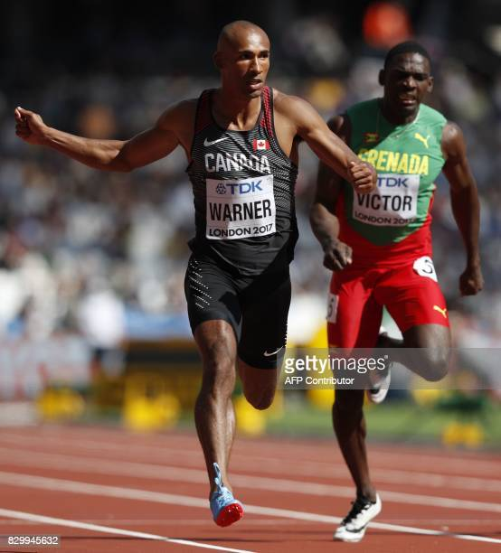 Canada's Damian Warner wins his heat in the men's decathlon 100m athletics event ahead of Grenada's Lindon Victor at the 2017 IAAF World...