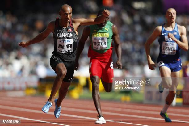 Canada's Damian Warner wins his heat in the men's decathlon 100m athletics event ahead of Grenada's Lindon Victor and US athlete Zach Ziemek at the...