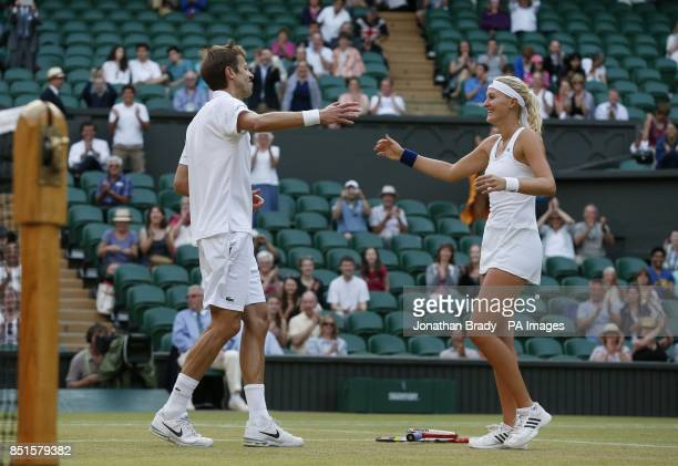 Canada's Daniel Nestor and France's Kristina Mladenovic celebrate winning their Mixed Doubles Final against Brazil's Bruno Soares and USA's Lisa...