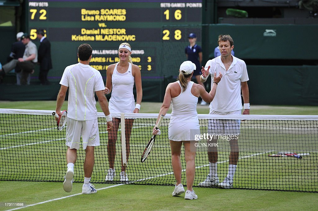 Canada's Daniel Nestor (R) and France's Kristina Mladenovic (2L) shake hands with Brazil's Bruno Soares (L) and US player Lisa Raymond (2R) after they won the mixed doubles final on day thirteen of the 2013 Wimbledon Championships tennis tournament at the All England Club in Wimbledon, southwest London, on July 7, 2013. AFP PHOTO / GLYN KIRK - RESTRICTED TO EDITORIAL USE
