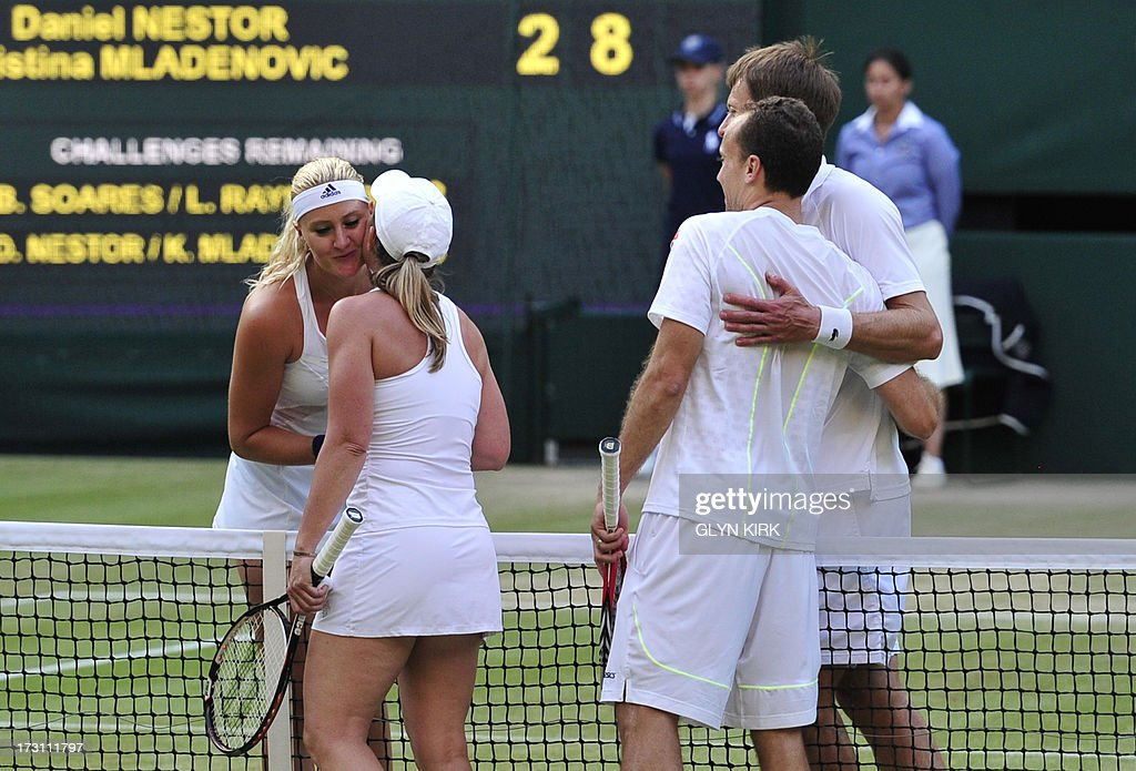 Canada's Daniel Nestor (R) and France's Kristina Mladenovic (L) shake hands with Brazil's Bruno Soares (2R) and US player Lisa Raymond (2L) after they won the mixed doubles final on day thirteen of the 2013 Wimbledon Championships tennis tournament at the All England Club in Wimbledon, southwest London, on July 7, 2013.