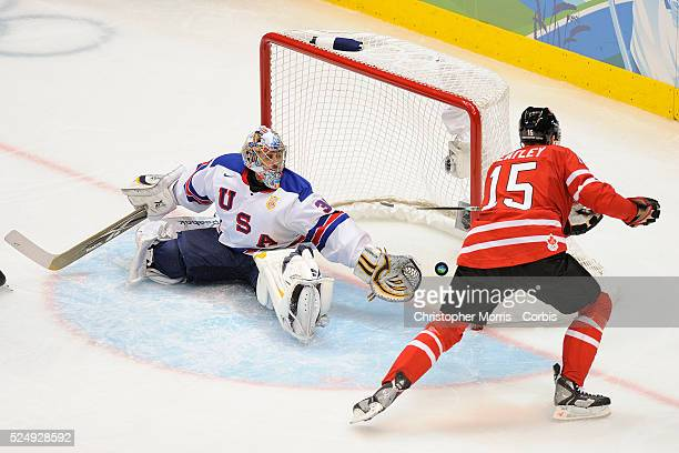 Canada's Dany Heatley scores a goal against USA's Ryan Miller during Canada vs USA preliminary round Ice Hockey action 2nd period at Canada Hockey...