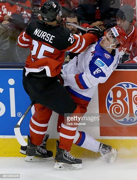 TORONTO JANUARY 5 Canada's Darnell Nurse hits Russia's Pavel Buchnevich along the boards 2015 IIHF World Junior Championship hockey 2nd period action...