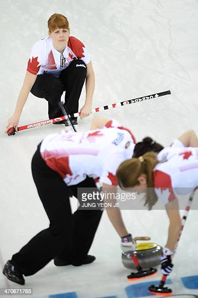 Canada's Dawn McEwen watches the stone during the Women's Curling Gold Medal Game Sweden vs Canada at the Ice Cube Curling Center during the Sochi...