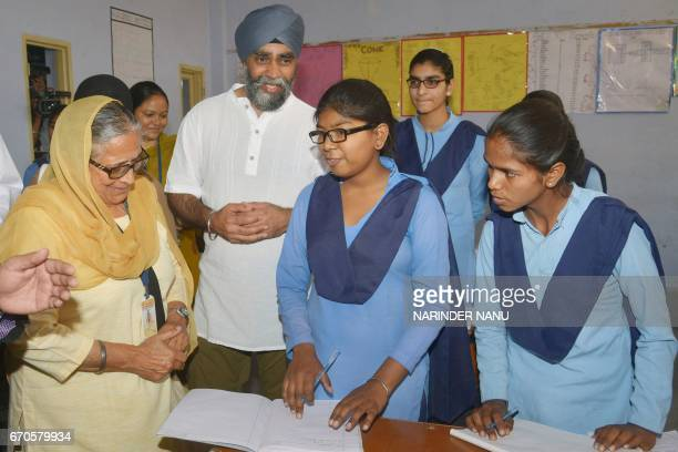 Canada's Defence Minister Harjit Singh Sajjan and All India Pingalwara Charitable Society president Inderjit Kaur talk with students during his visit...