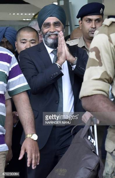 Canada's Defence Minister Harjit Singh Sajjan gestures as he arrives at an airport on the outskirts of Amritsar on April 19 ahead of his scheduled...