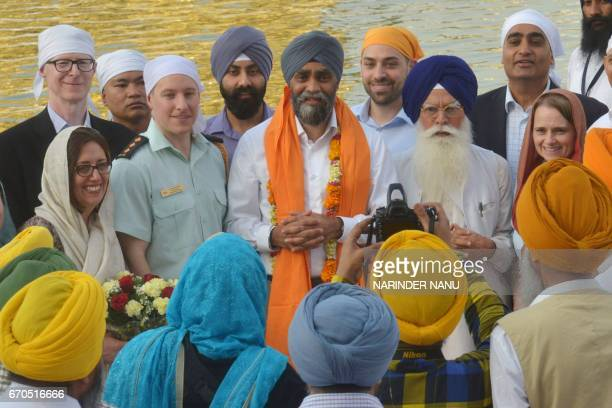 Canada's Defence Minister Harjit Singh Sajjan joins Shiromani Gurdwara Parbandhak Committee chief Kirpal Singh Badungar to pay respects at the Sikh...