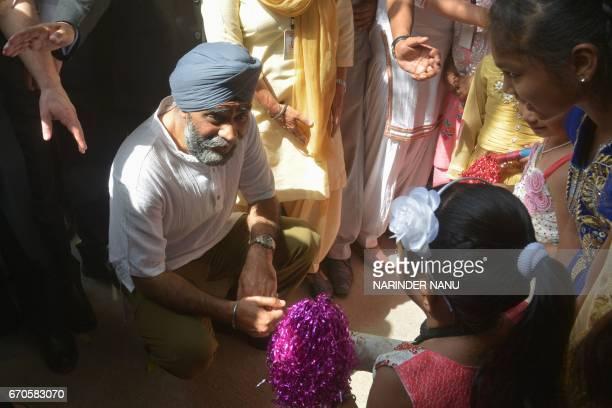 Canada's Defence Minister Harjit Singh Sajjan talk with children during his visit to the All India Pingalwara Charitable Society at Manawala village...