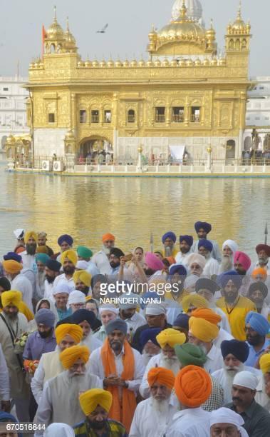 Canada's Defence Minister Harjit Singh Sajjan visits the Sikh Golden Temple in Amritsar on April 20 2017 / AFP PHOTO / NARINDER NANU