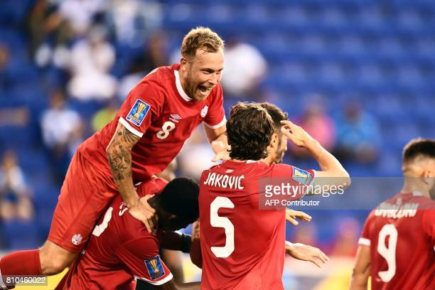 Canada's defender Dejan Jakovic celebrates with teammates after scoring a goal against French Guiana during their 2017 Concacaf Gold Cup Group A...