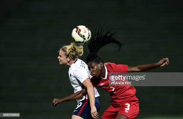 Canada's defender Kadeisha Buchanan and France's forward Eugenie Le Sommer jump for the ball during the friendly football match France vs Canada on...