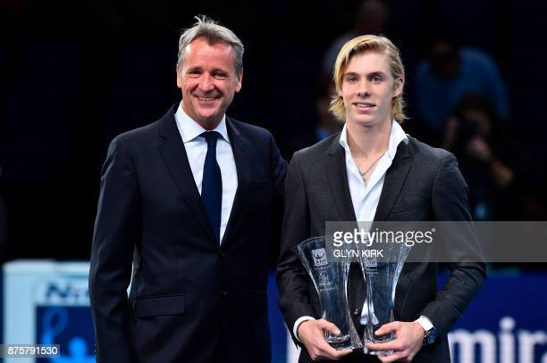 Canada's Denis Shapovalov poses with the ATP Star of Tomorrow award and the Most Improved Player award with ATP Executive Chairman and President...
