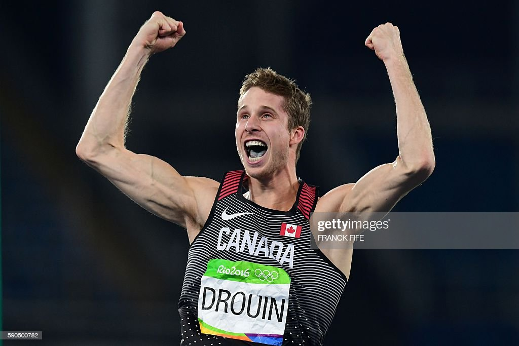 TOPSHOT - Canada's Derek Drouin celebrates winning the Men's High Jump Final during the athletics event at the Rio 2016 Olympic Games at the Olympic Stadium in Rio de Janeiro on August 16, 2016. / AFP / FRANCK