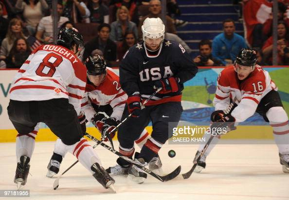 Canada's Drew Doughty Duncan Keith and Jonathan Toews fight for the puck against Phil Kessel of the US in the men's gold medal Ice Hockey match...