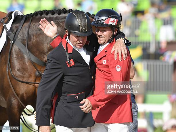 Canada's Eric Lamaze and Britain's Nick Skelton greet each other after the final round of the individual equestrian show jumping event at the Olympic...