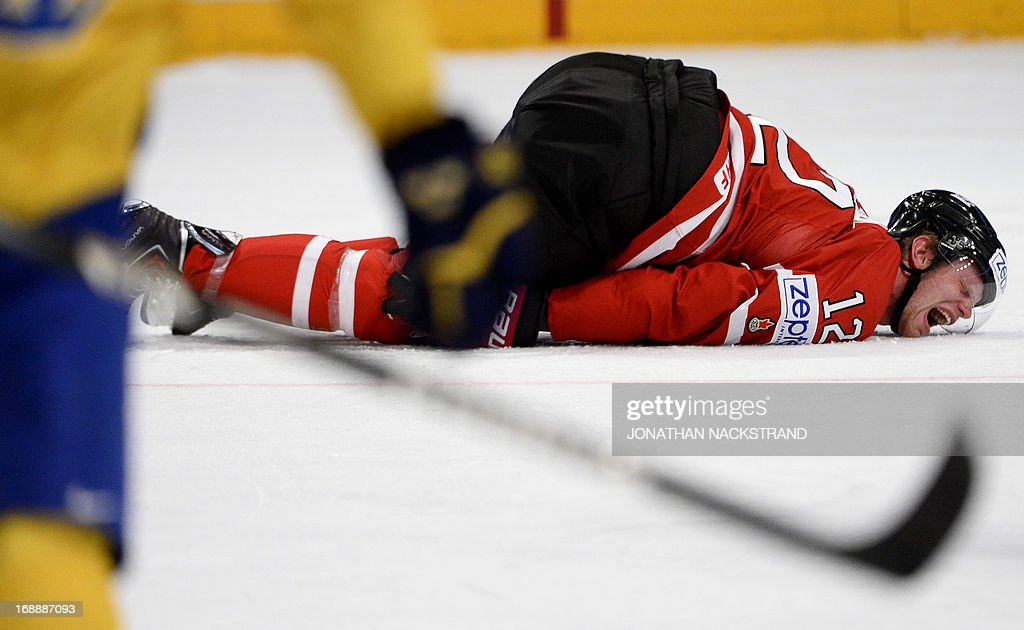 Canada's Eric Staal lies injured on the ice after a hit by Sweden's Alexander Edler (unseen) during the quarterfinals match Canada vs Sweden at the 2013 IIHF Ice Hockey World Championships on May 16, 2013 in Stockholm. AFP PHOTO/JONATHAN NACKSTRAND