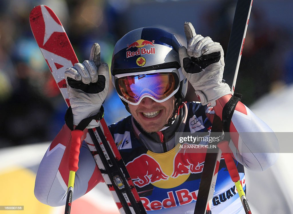 Canada's Erik Guay reacts after competing in the FIS World Cup men's downhill race on January 26, 2013 in Kitzbuehel, Austrian Alps. Italy's Dominik Paris won the event, Canada's Erik Guay finished second and Austria's Hannes Reichelt third. AFP PHOTO / ALEXANDER KLEIN