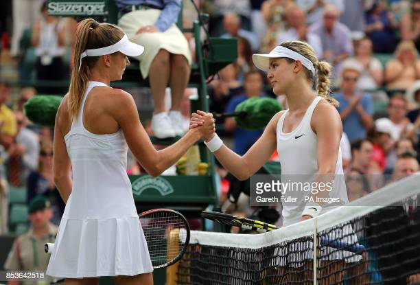 Canada's Eugenie Bouchard and Slovakia's Daniela Hantuchova shake hands after their match during day two of the Wimbledon Championships at the All...