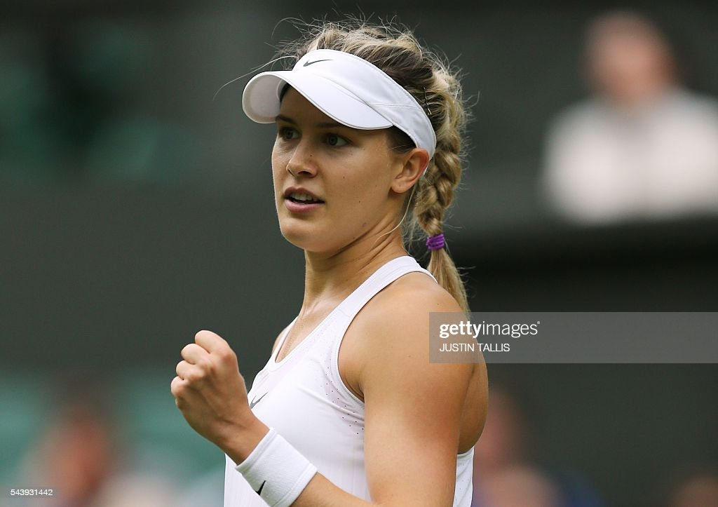 Canada's Eugenie Bouchard celebrates a point against Britain's Johanna Konta during their women's singles second round match on the fourth day of the 2016 Wimbledon Championships at The All England Lawn Tennis Club in Wimbledon, southwest London, on June 30, 2016. / AFP / JUSTIN