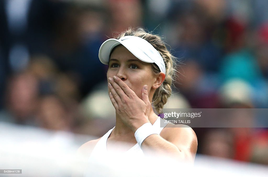 Canada's Eugenie Bouchard celebrates after beating Britain's Johanna Konta in their women's singles second round match on the fourth day of the 2016 Wimbledon Championships at The All England Lawn Tennis Club in Wimbledon, southwest London, on June 30, 2016. / AFP / JUSTIN