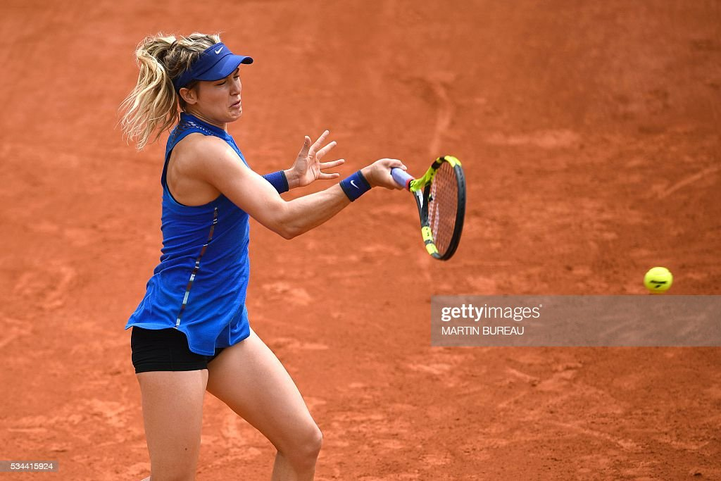 Canada's Eugenie Bouchard returns the ball to Switzerland's Timea Bacsinszky during their women's second round match at the Roland Garros 2016 French Tennis Open in Paris on May 26, 2016. / AFP / MARTIN
