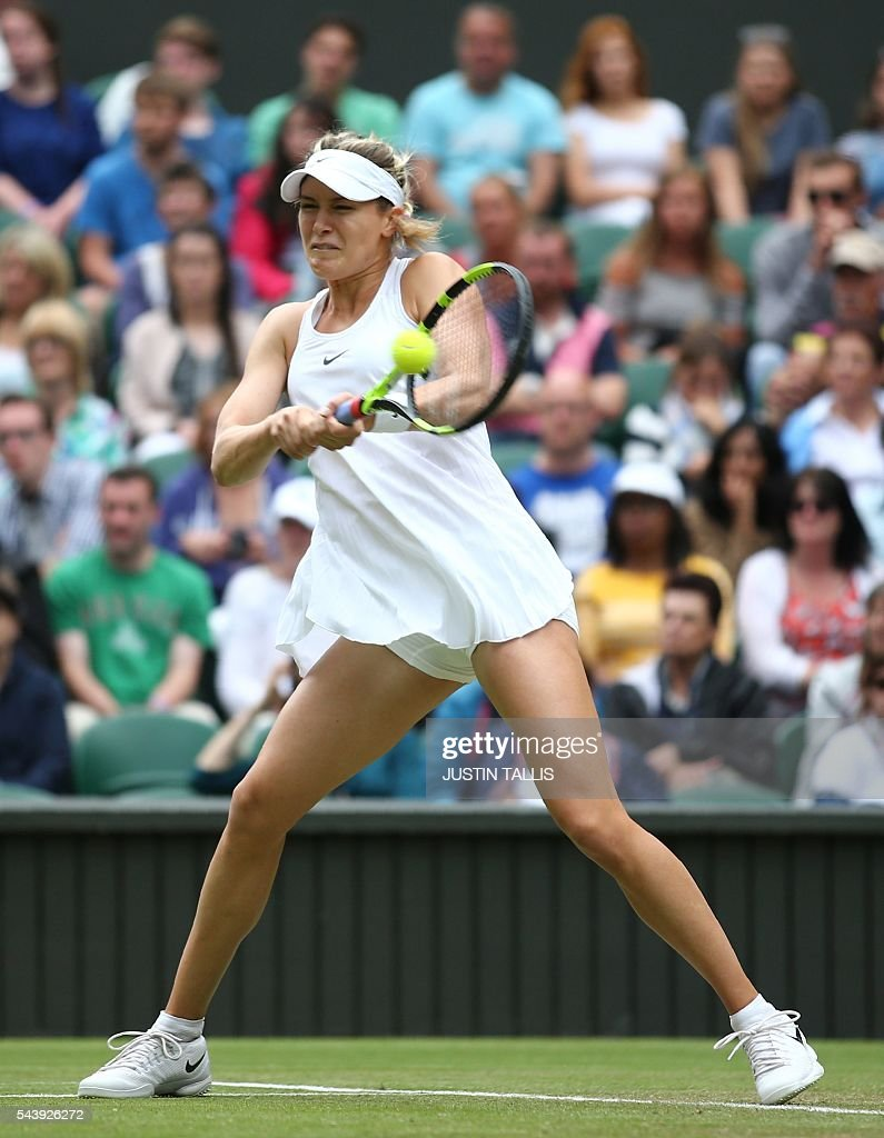 Canada's Eugenie Bouchard returns to Britain's Johanna Konta during their women's singles second round match on the fourth day of the 2016 Wimbledon Championships at The All England Lawn Tennis Club in Wimbledon, southwest London, on June 30, 2016. / AFP / JUSTIN