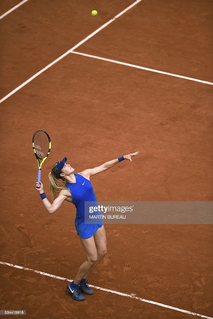Canada's Eugenie Bouchard serves the ball to Switzerland's Timea Bacsinszky during their women's second round match at the Roland Garros 2016 French Tennis Open in Paris on May 26, 2016. / AFP / MARTIN