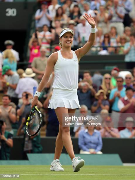 Canada's Eugenie Bouchard waves to the crowd after beating Slovakia's Daniela Hantuchova during day two of the Wimbledon Championships at the All...
