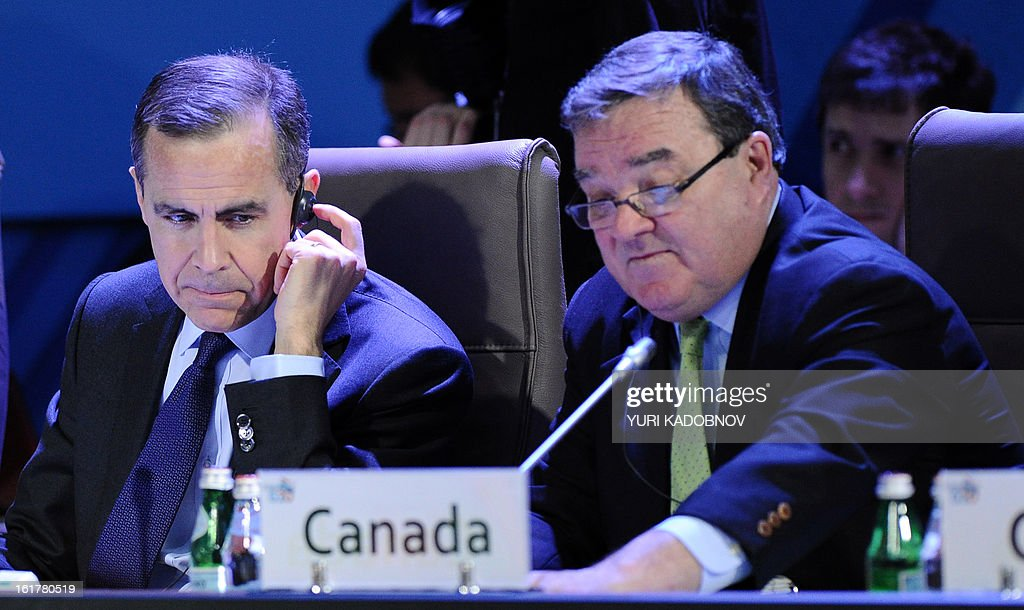 Canada's Finance Minister Jim Flaherty (R) and Mark Carney, Governor of the Bank of Canada, attend a meeting of G20 states finance ministers and central bank governors' deputies attend their meeting in Moscow, on February 16, 2013. The ministers and central bank governors' deputies gathered today in Moscow for their first meeting in the Russian capital aimed at reassuring markets that the world's economic powers would not slug it out in 'currency wars' to boost national growth.