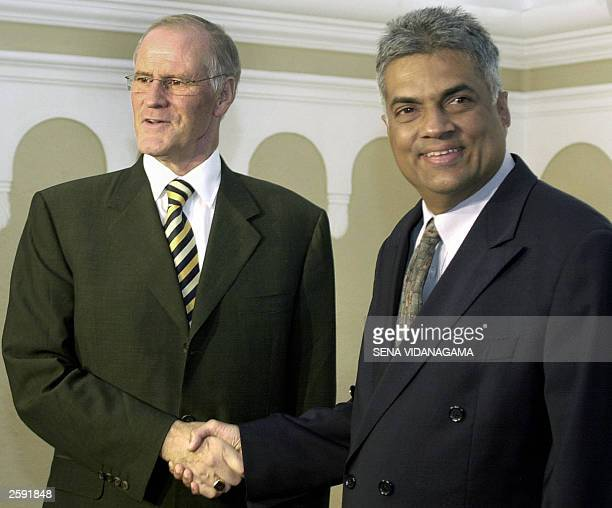 Canada''s Foreign Minister Bill Graham shakes hands with Sri Lankan Prime Minister Ranil Wickremesinghe in Colombo 15 October 2003 Graham is on a...